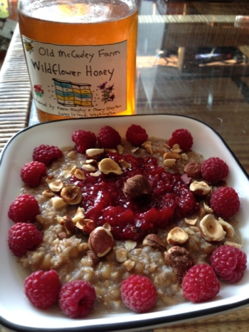 breakfast of sprouted fermented wheat plus hazelnuts berries and honey